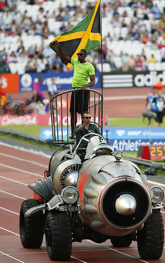 Bolt parades around Queen Elizabeth Olympic Park on a rocket-like vehicle before the start of the Diamond League athletics meet in London.