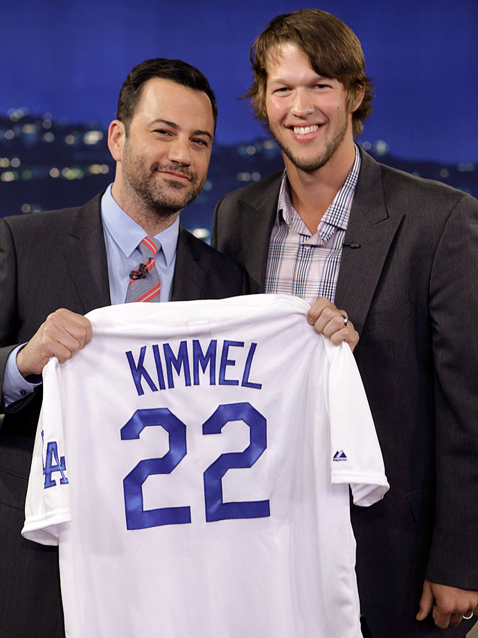 "Jimmy Kimmel holds up a jersey given to him by Clayton Kershaw after taping ""Jimmy Kimmel Live"" on July 29, 2013 in Hollywood, Calif."