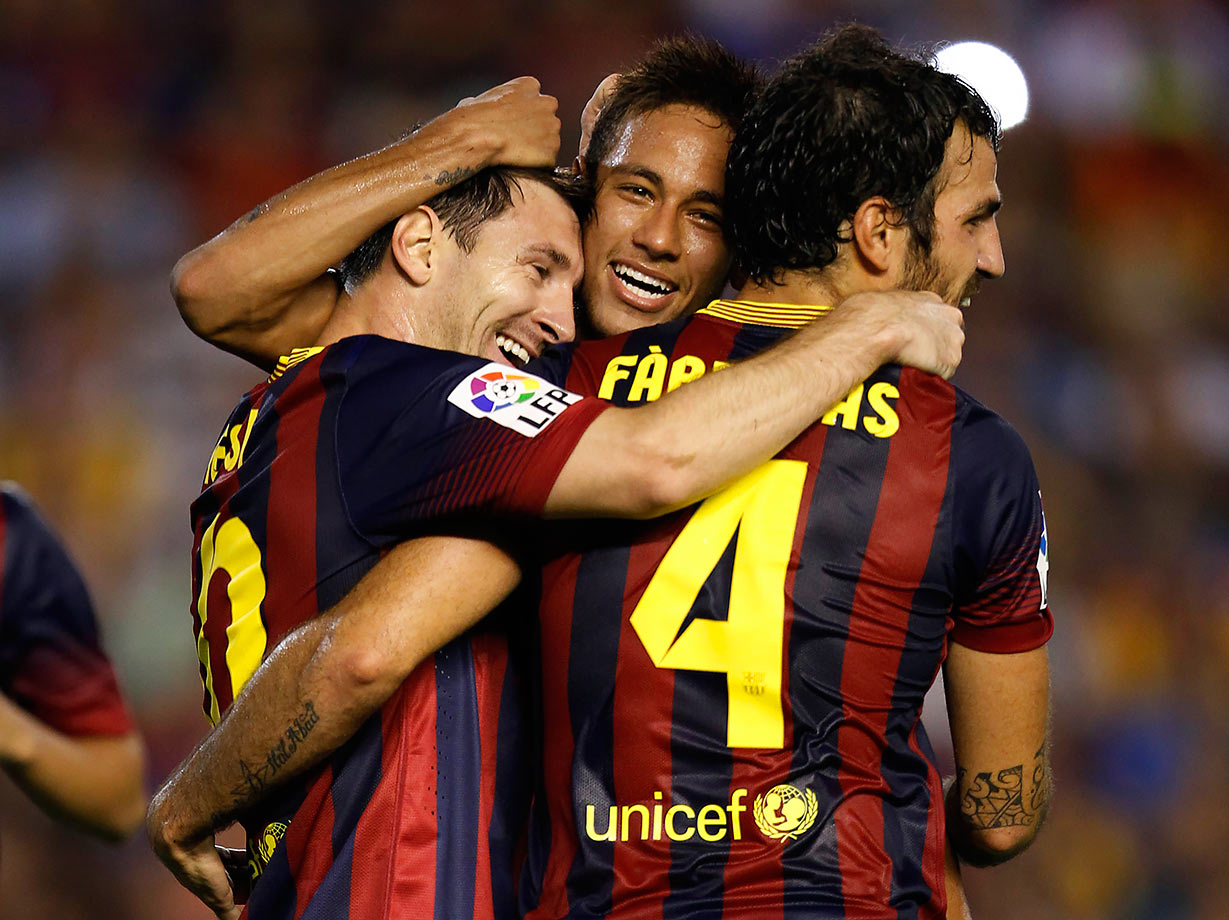 Neymar celebrates with Barcelona teammates Lionel Messi and Cesc Fabregas after Messi scored his third goal against Valencia during their La Liga match on Sept. 1, 2013 at Mestalla Stadium in Valencia, Spain.