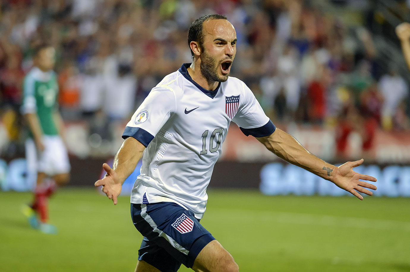 Landon Donovan celebrates after scoring a goal against Mexico in the Final Round of the CONCACAF World Cup Qualifying match for the FIFA 2014 Brazil World Cup at the Columbus Crew Stadium in Columbus, Ohio.