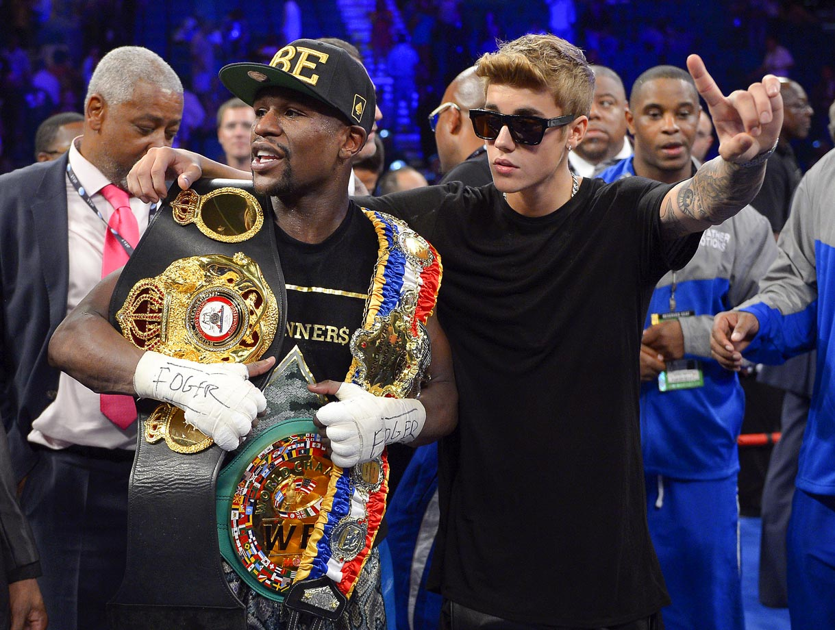 Floyd Mayweather Jr. and Justin Bieber pose together after Mayweather defeated Saul 'El Canelo' Alvarez by majority decision in their WBC/WBA 154-pound title fight on Sept. 14, 2013 at the MGM Grand Garden Arena in Las Vegas.