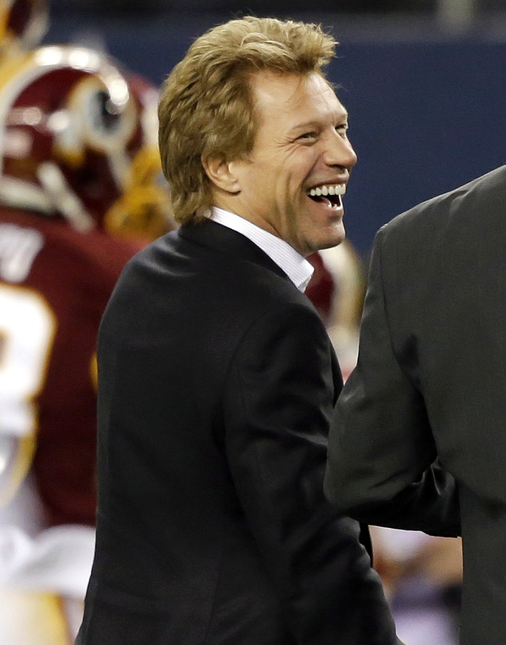 Jon Bon Jovi laughs on the sideline prior to the Dallas Cowboys game against the Washington Redskins in Arlington, Texas.