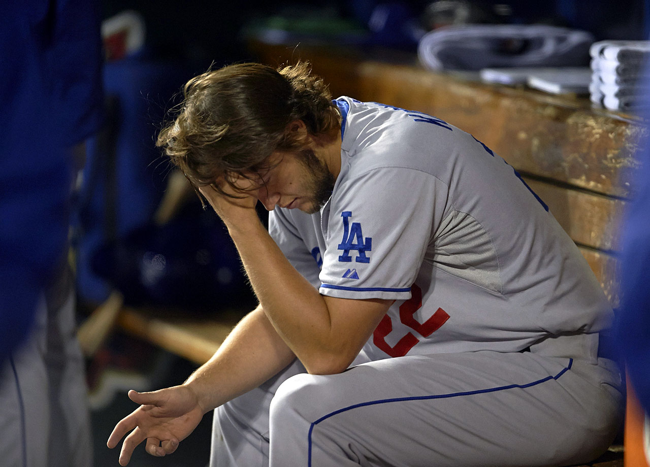 Clayton Kershaw sits dejected in the dugout after allowing seven earned runs in four innings, losing Game 6 of the NLCS and the Dodgers' series against the Cardinals on Oct. 18, 2013 at Busch Stadium in St. Louis.