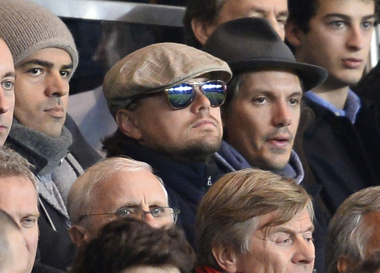 Leonardo DiCaprio and Lukas Haas attend the UEFA Champions League football match between Paris Saint-Germain (PSG) and RSC Anderlecht (RSCA) at the Parc des Princes in Paris, France.