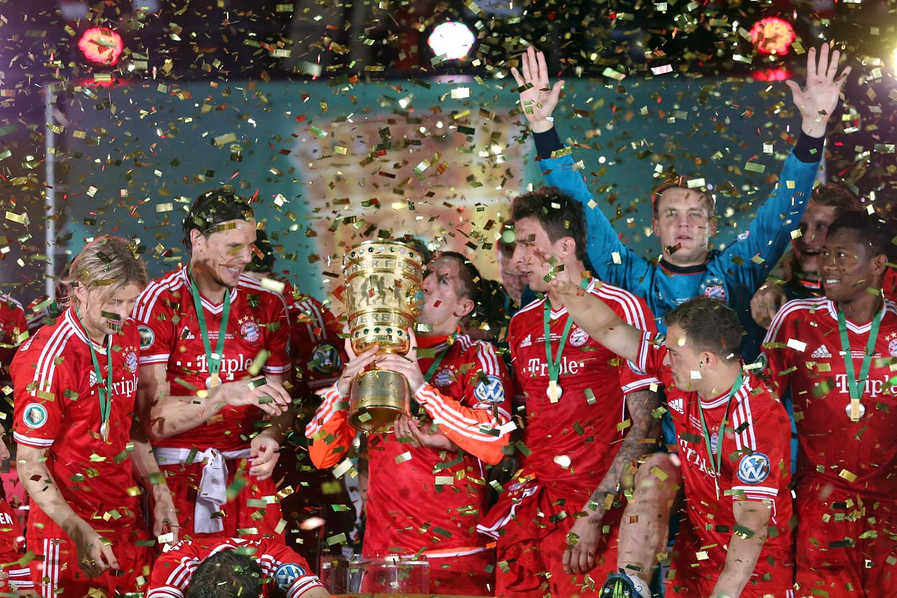 Bayern completes the first treble in German soccer history, winning the DFB-Pokal via a 3-2 triumph over Stuttgart.