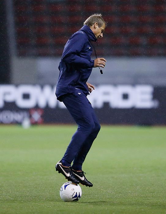 Klinsmann warms up prior to a training session in September 2013 in San Jose, Costa Rica.