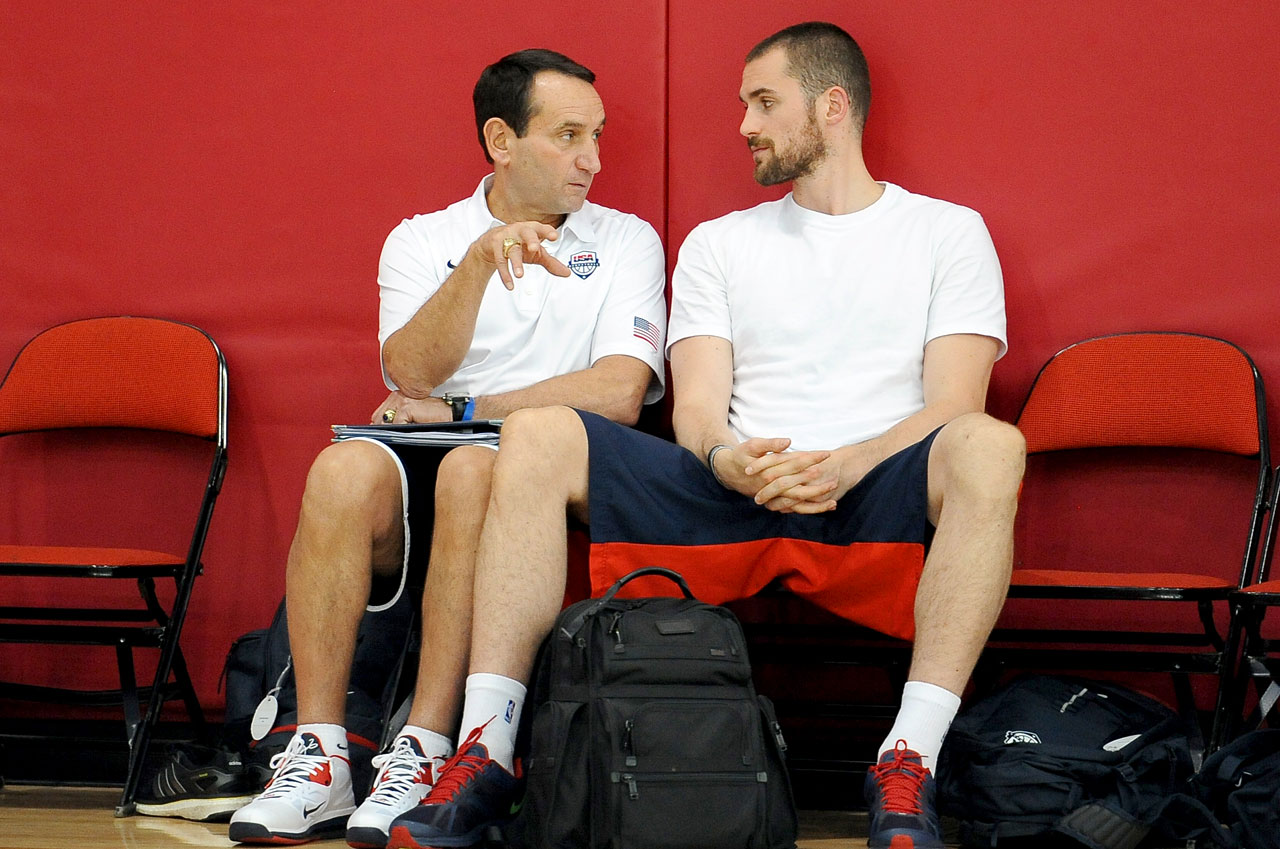 Love chats with Team USA coach Mike Krzyzewski during a minicamp.