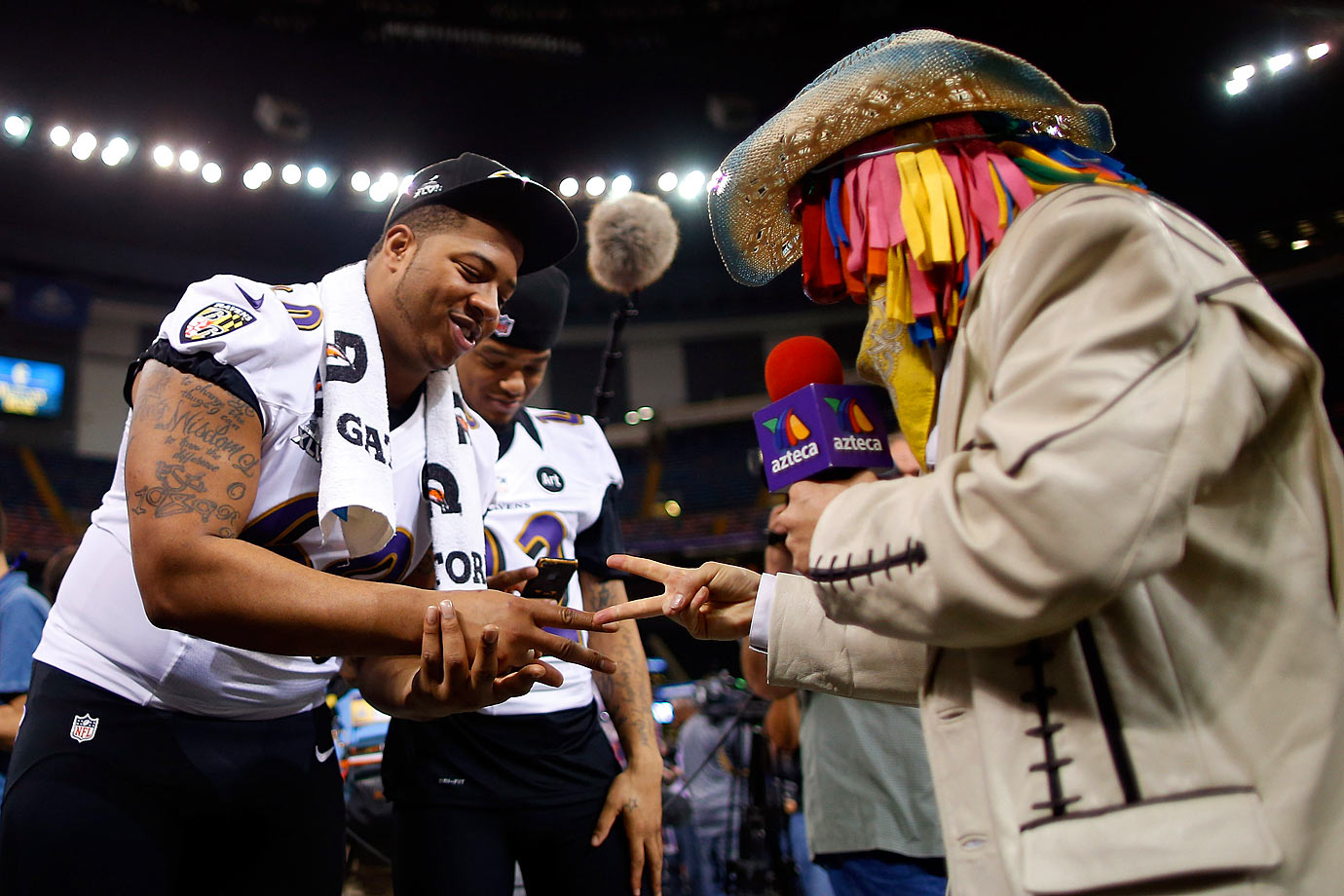 Ravens offensive lineman Antoine McClain plays rock, paper, scissors during Super Bowl XLVII Media Day in New Orleans.