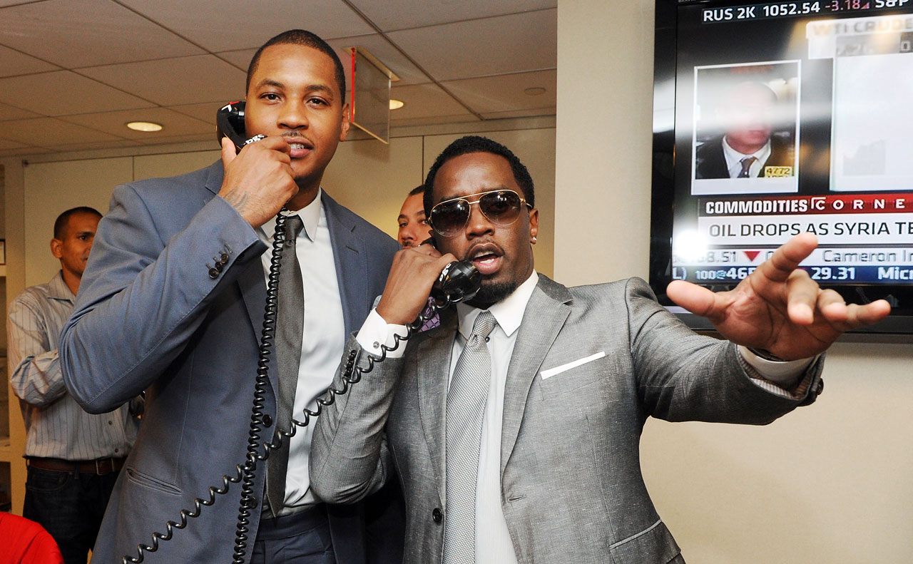 Anthony and Diddy play stock brokers while attending the annual charity day hosted by Cantor Fitzgerald and BGC at the BGC office in New York City.