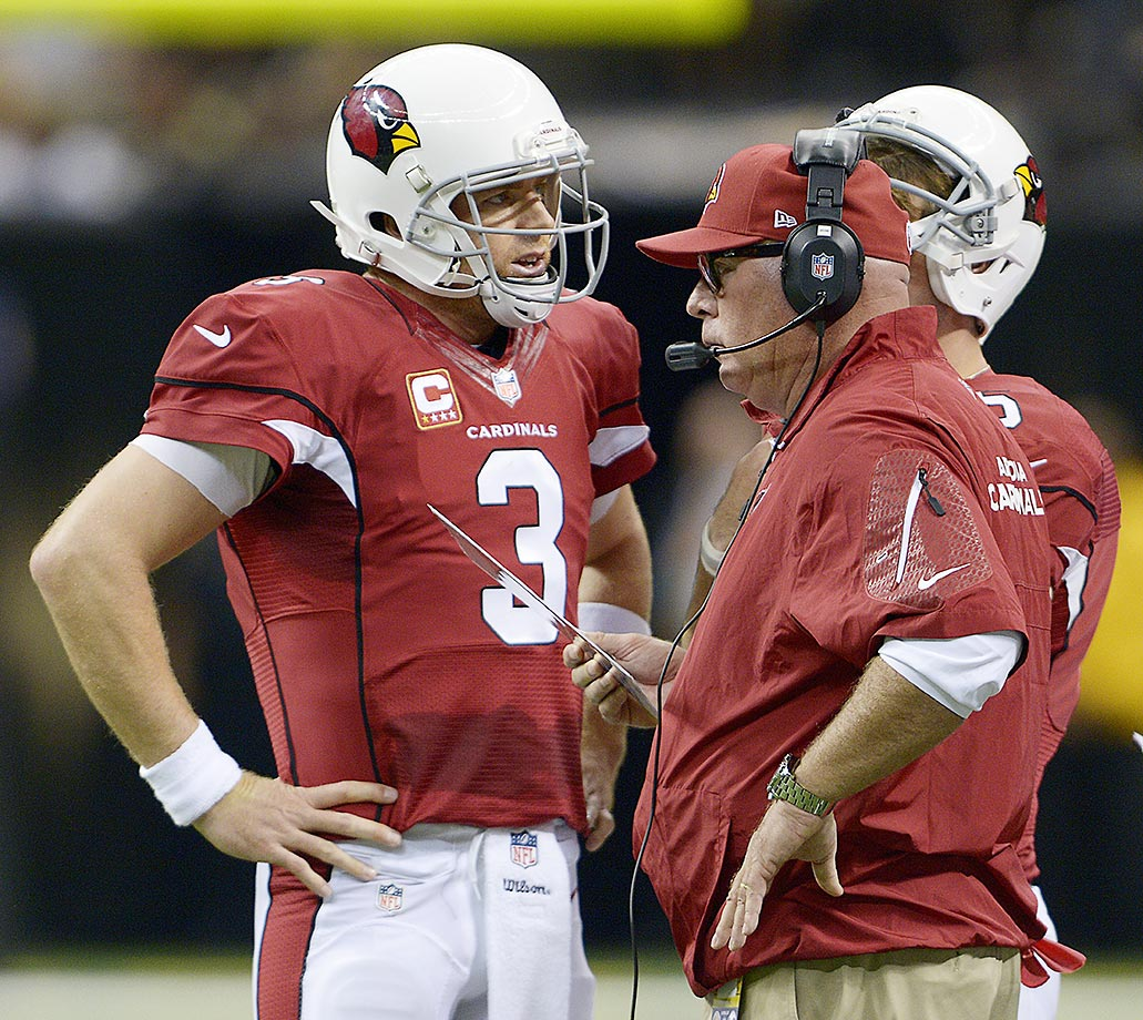 Arizona head coach Bruce Arians talks to quarterback Palmer during a game against the New Orleans Saints. The Cardinals went 10-6 in Palmer's first season in the desert but missed the playoffs.