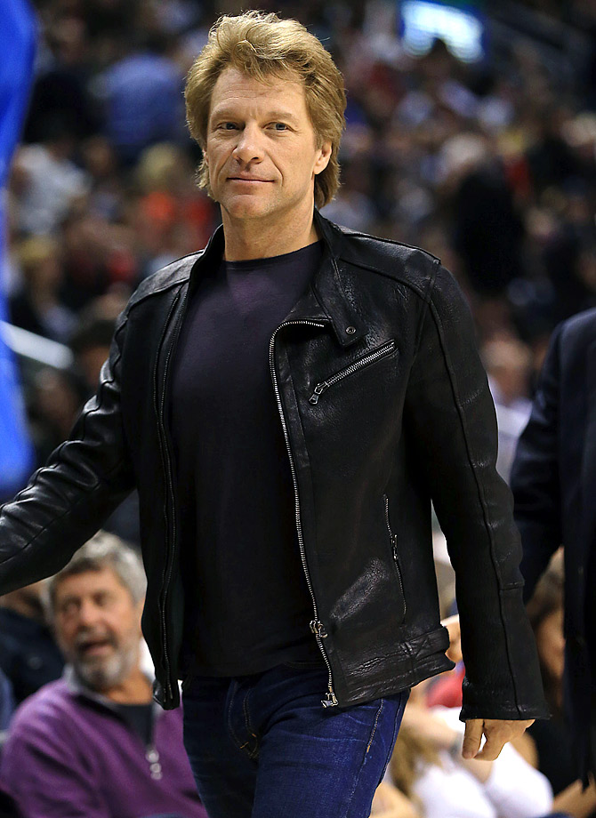 Jon Bon Jovi walks court side as he attends the Toronto Raptors game against the Boston Celtics at the Air Canada Centre in Toronto.