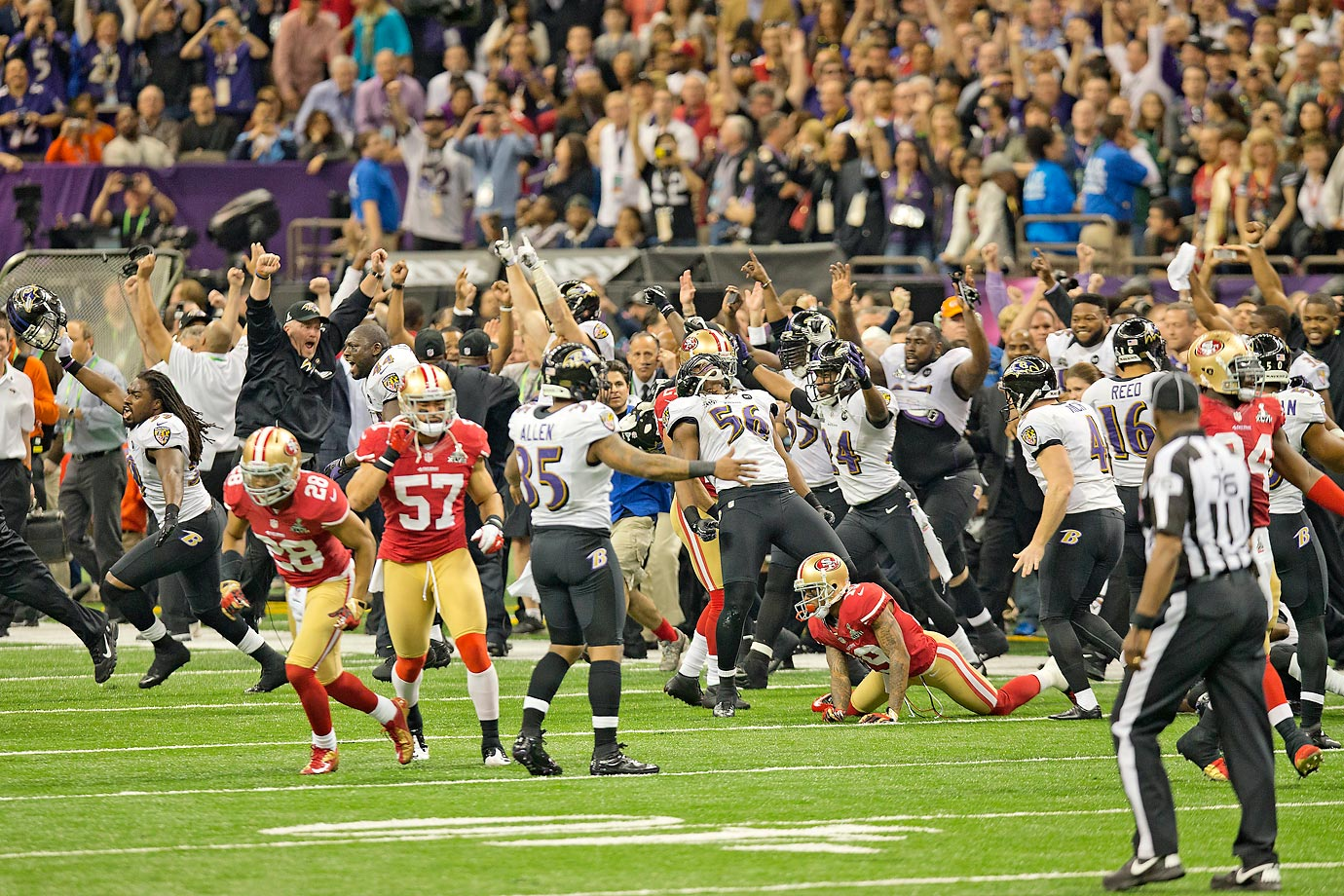 Baltimore Ravens pour onto the field to celebrate their victory -- San Francisco's first ever in a Super Bowl.