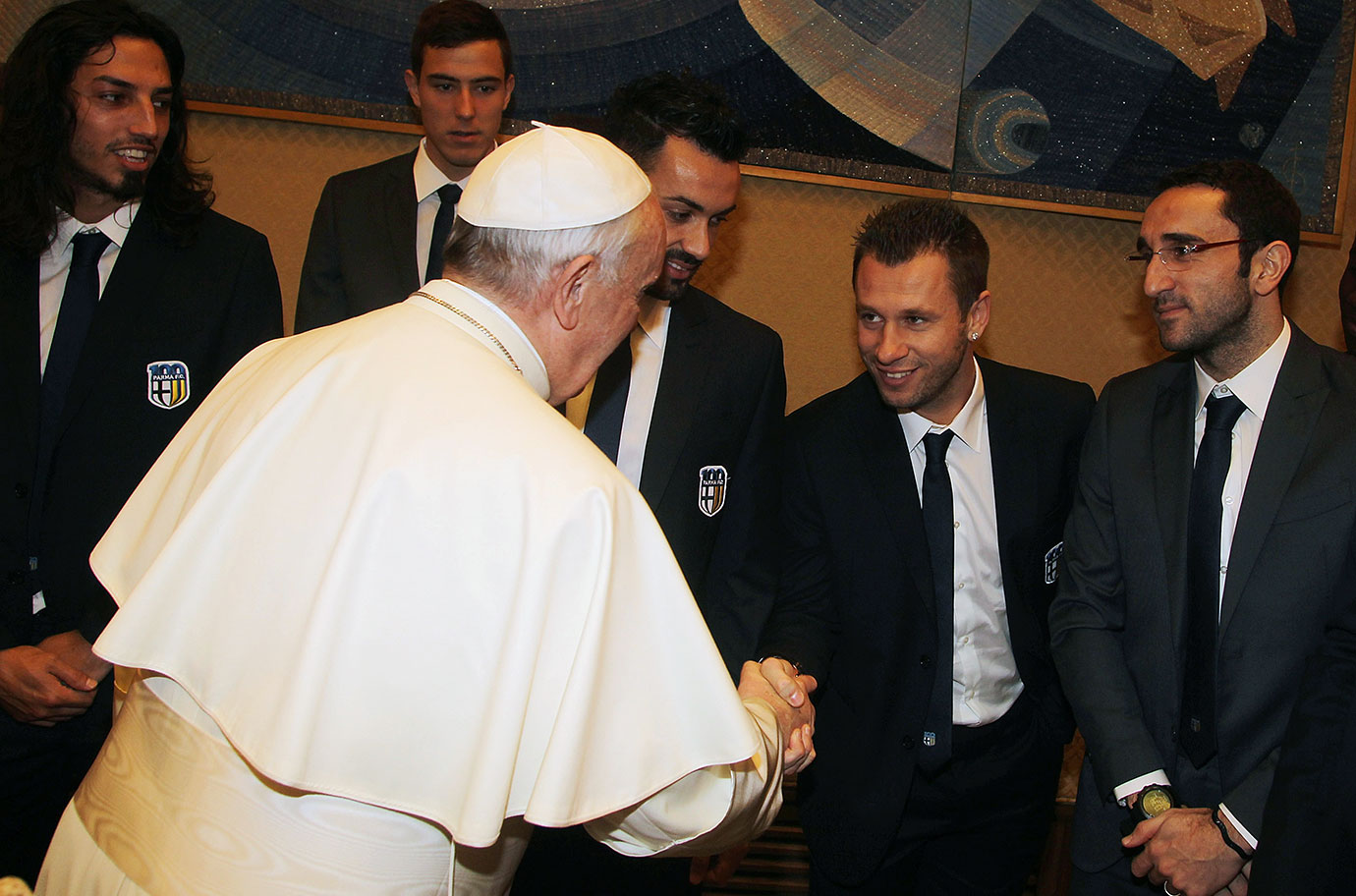 Pope Francis shakes hands with Antonio Cassano of FC Parma during an audience at The Vatican on February 1, 2014 in Vatican City.