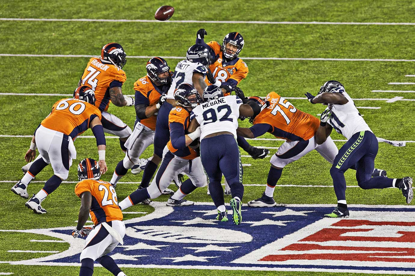 Denver Broncos quarterback Peyton Manning fumbles after a sack by Seattle Seahawks defensive end Michael Bennett. It was one of four Broncos turnovers on the night as Seattle dominated Denver, 43-8.