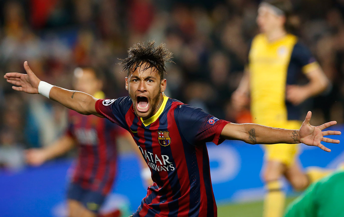 Neymar celebrates after scoring Barcelona's first goal during a first leg quarterfinal Champions League match against Atletico Madrid on April 1, 2014 at Camp Nou in Barcelona, Spain.