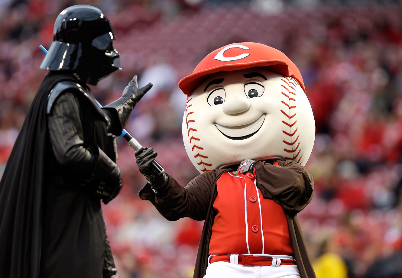 Cincinnati Reds mascot Mr. Red pretends to be choked by Darth Vader prior to the Reds game against the Milwaukee Brewers on May 2, 2014 at Great American Ballpark in Cincinnati.