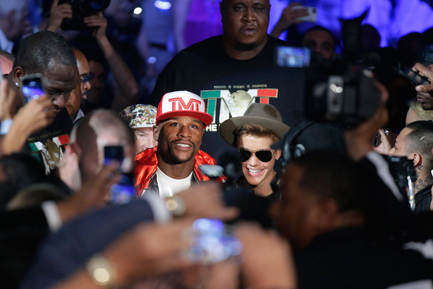 Floyd Mayweather Jr. is joined by Justin Bieber celebrate as he heads to the ring for his WBC/WBA welterweight unification fight against Marcos Maidana on May 3, 2014 at the MGM Grand Garden Arena in Las Vegas.