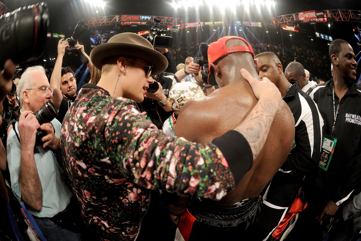 Justin Bieber and Floyd Mayweather Jr. celebrate after Mayweather defeated Marcos Maidana by majority decision in their WBC/WBA welterweight unification fight on May 3, 2014 at the MGM Grand Garden Arena in Las Vegas.