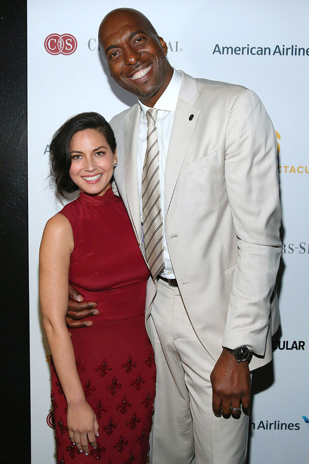 Olivia Munn and John Salley pose backstage at the 2014 Sports Spectacular Gala at the Hyatt Regency Century Plaza on May 18, 2014 in Century City, Calif.