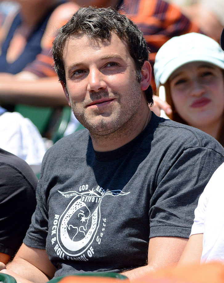 Ben Affleck looks on and smiles as he watches the Detroit Tigers game against the Texas Rangers on May 25, 2014 at Comerica Park in Detroit.