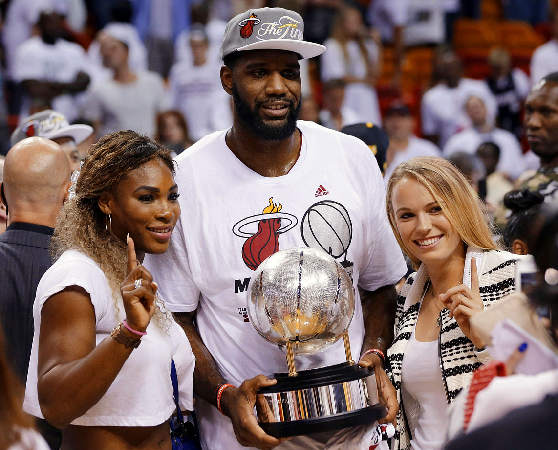 Serena Williams and Caroline Wozniacki pose with Greg Oden and the Eastern Conference championship trophy after the Miami Heat defeated the Indiana Pacers in Game Six of the Eastern Conference Finals on May 30, 2014 at American Airlines Arena in Miami.