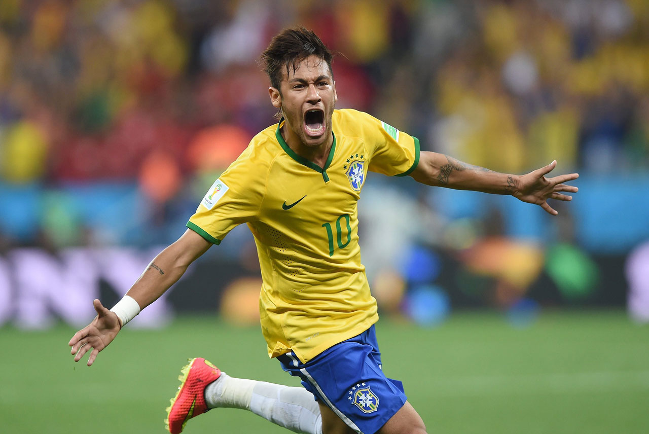 Neymar celebrates a goal during Brazil's World Cup match against Croatia on June 12, 2014 at the Arena de Sao Paulo in Brazil.