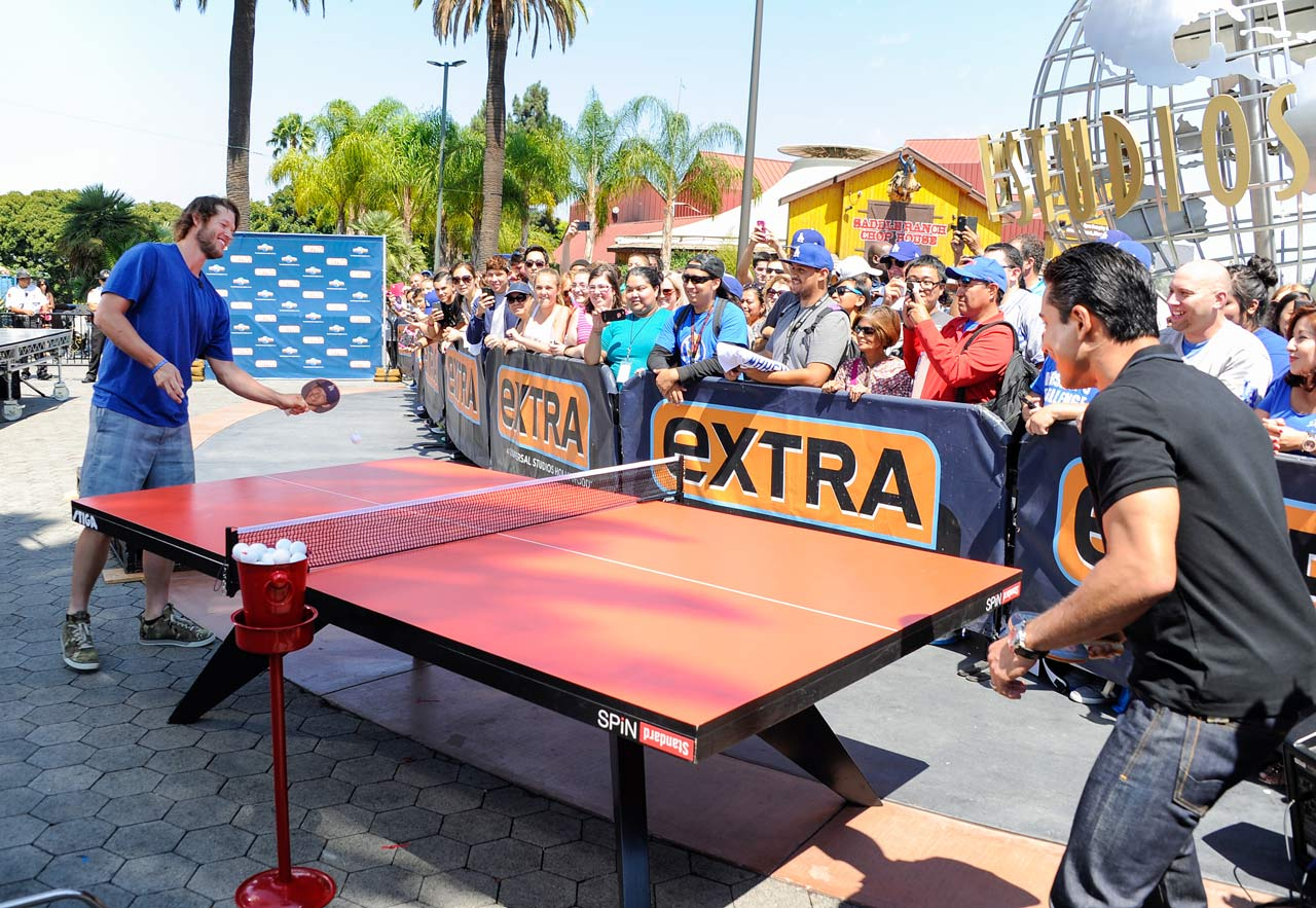 "Clayton Kershaw plays ping pong against Mario Lopez on ""Extra"" at Universal Studios Hollywood on Aug. 20, 2014 in Universal City, Calif."