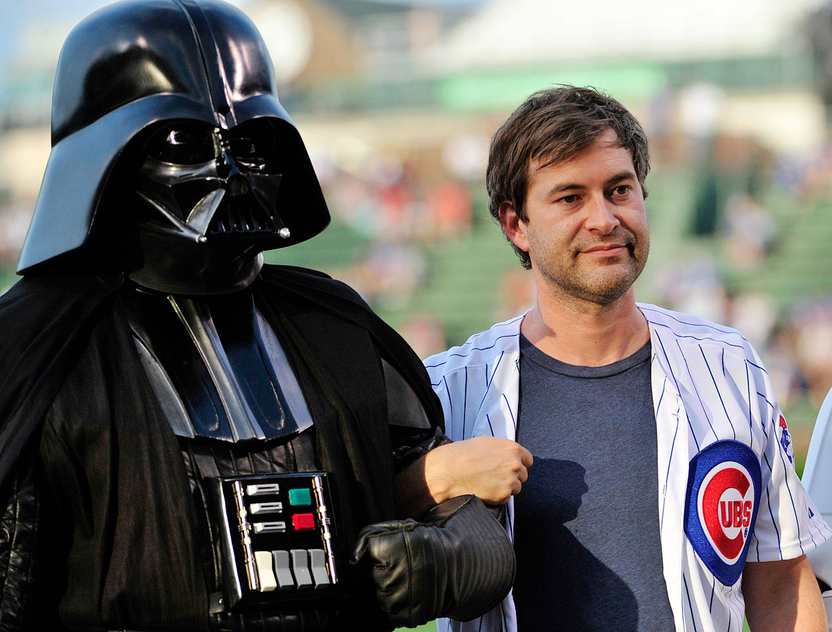 "Darth Vader and Mark Duplass wait to throw out the ceremonial first pitch before the game between the Chicago Cubs and the San Francisco Giants on ""Star Wars Night"" on Aug. 20, 2014 at Wrigley Field in Chicago."
