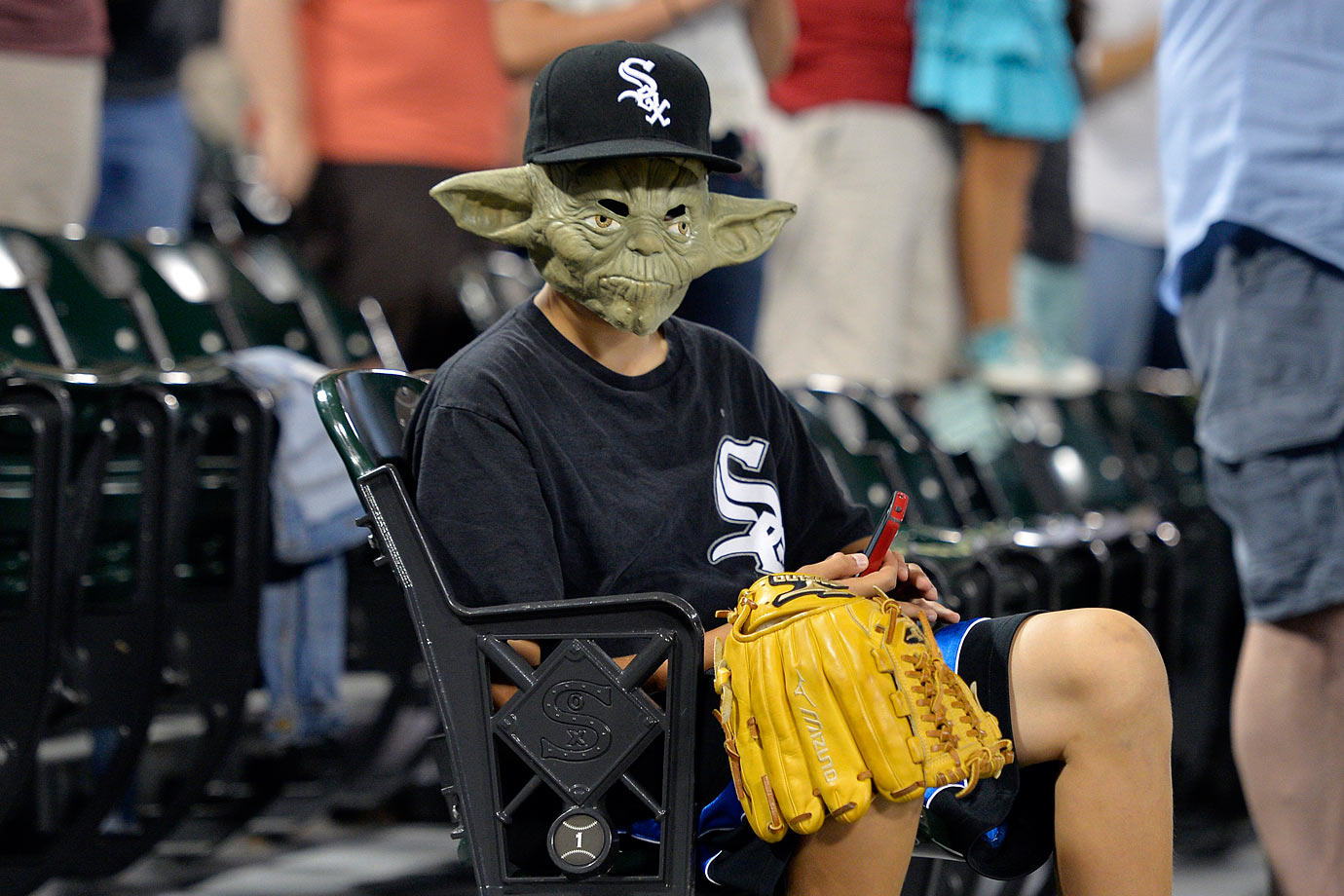 "A Chicago White Sox fan wears a Yoda mask during the White Sox game against the Cleveland Indians during ""Star Wars Night' on Aug. 29, 2014 at U.S. Cellular Field in Chicago."