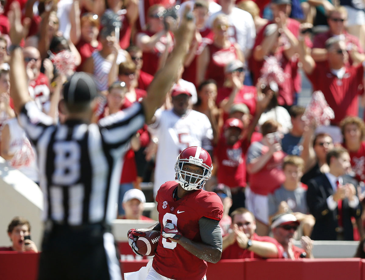 Bama blanked the Owls in a game called early because of lightning. That didn't stop Amari Cooper from going off: He had 13 catches for 189 yards and a touchdown.