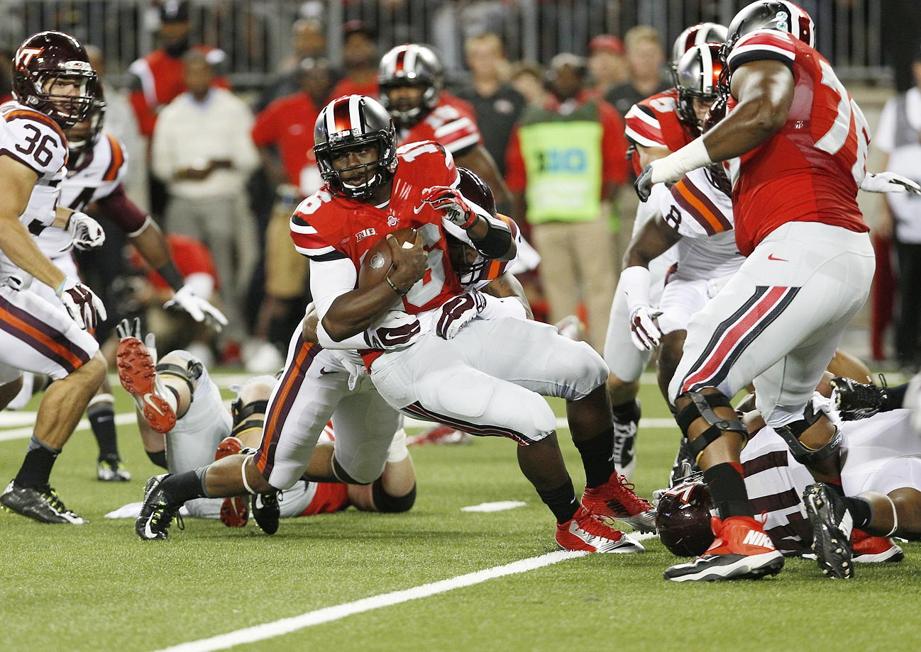 Disaster struck early for the Buckeyes as Virginia Tech -- which went on to barely get to bowl eligibility -- took down Ohio State in Columbus, breaking through a porous Buckeyes offensive line for seven sack while limiting Barrett to 9-of-29 passing with three interceptions.