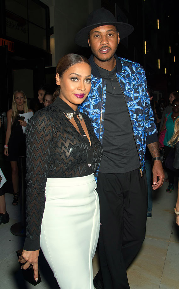 Carmelo Anthony and La La Anthony attend the Versus Versace Spring 2015 Collection during Mercedes-Benz Fashion Week at Metropolitan West in New York City.