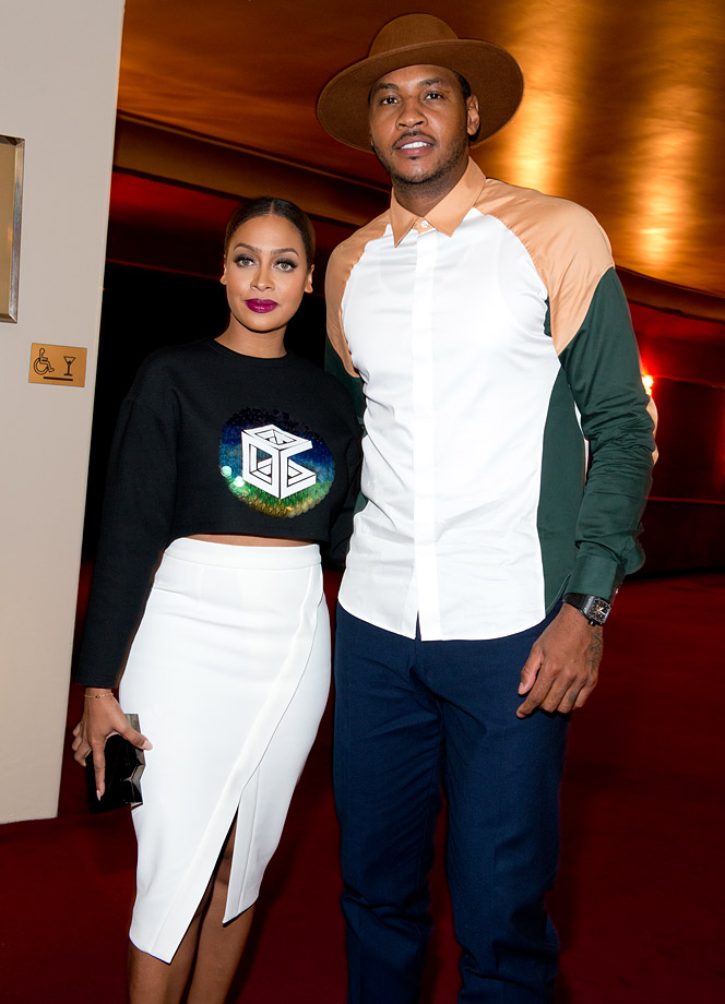 Carmelo Anthony and La La Anthony attend the Opening Ceremony fashion show during Mercedes-Benz Fashion Week Spring 2015 in New York City.