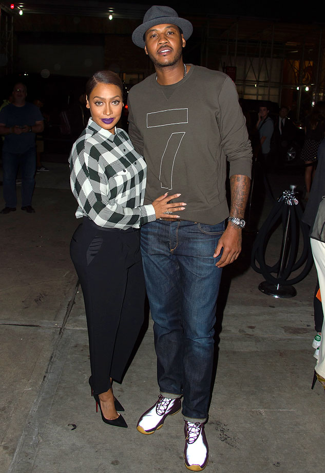 Carmelo Anthony and La La Anthony attend Rag & Bone during Mercedes-Benz Fashion Week Spring 2015 at Skylight at Moynihan Station in New York City.