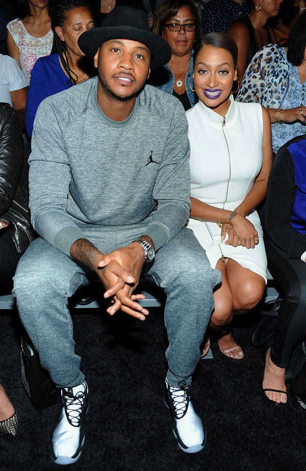 Carmelo Anthony and La La Anthony attend the Nike/Levi Kids fashion show during Mercedes-Benz Fashion Week Spring 2015 at Cafe Rouge in New York City.