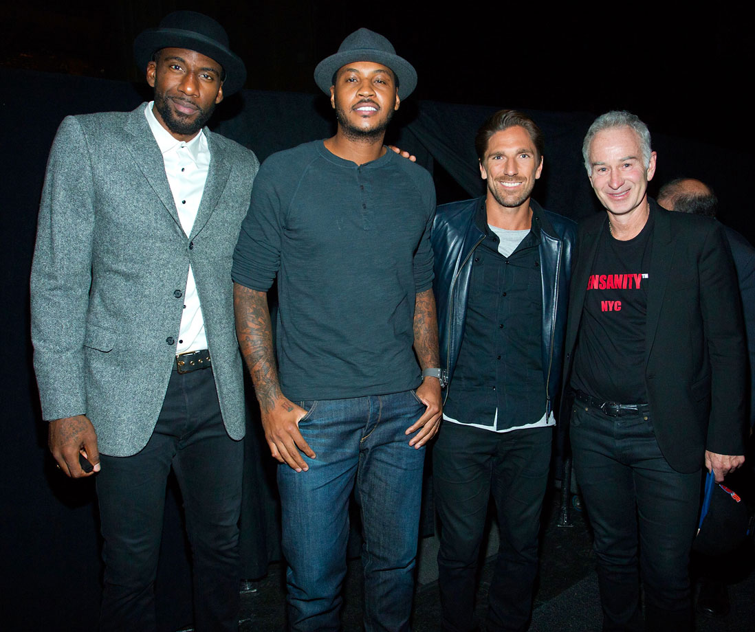 Carmelo Anthony poses with Amar'e Stoudemire, Henrik Lundqvist and John McEnroe during Jim Dolan's kazoo world record to donate $100,000 to the ALS Association at Madison Square Garden in New York City.