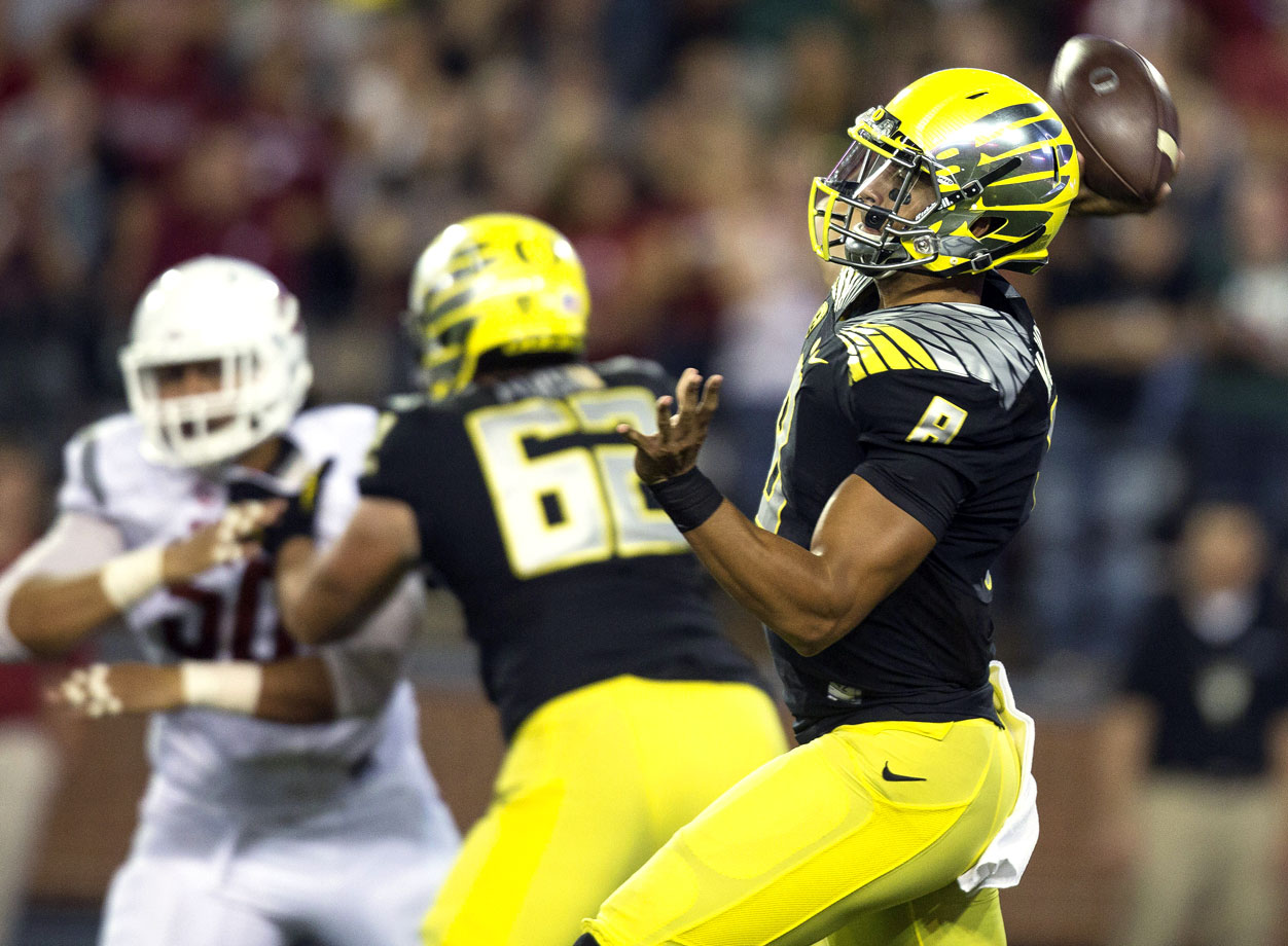 "Ducks coach Mark Helfrich called Mariota's game ""ridiculous"" after the Oregon quarterback threw for 329 yards and five touchdowns in the team's first road test. Mariota also led the game-winning nine-play, 79-yard drive that ended in a six-yard touchdown pass to Keanon Lowe."