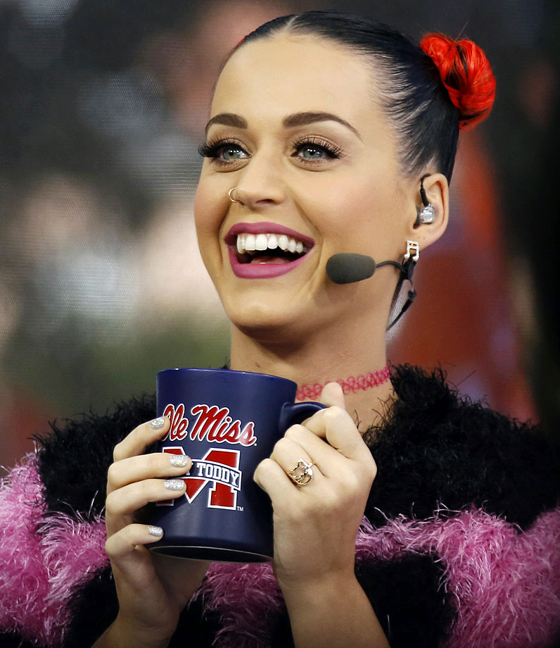 Katy Perry holds up an Ole Miss mug during a telecast of ESPN's College GamDay in The Grove at the University of Mississippi prior to their game against Alabama on Oct. 4, 2014 at Vaught-Hemingway Stadium in Oxford, Miss.