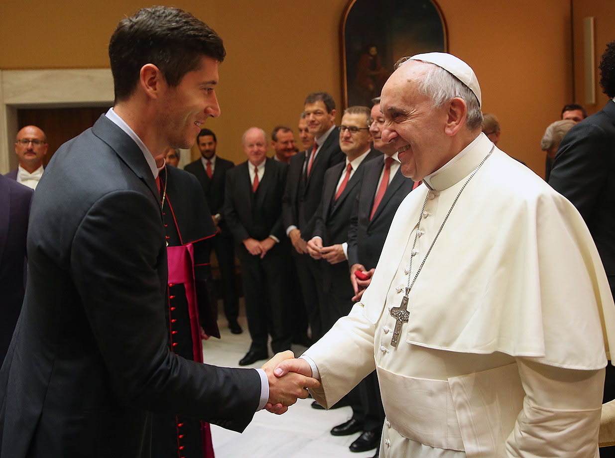 Pope Francis shakes hands with Robert Lewandowski of FC Bayern Muenchen during a private audience at The Vatican October 22, 2014 in Vatican City.