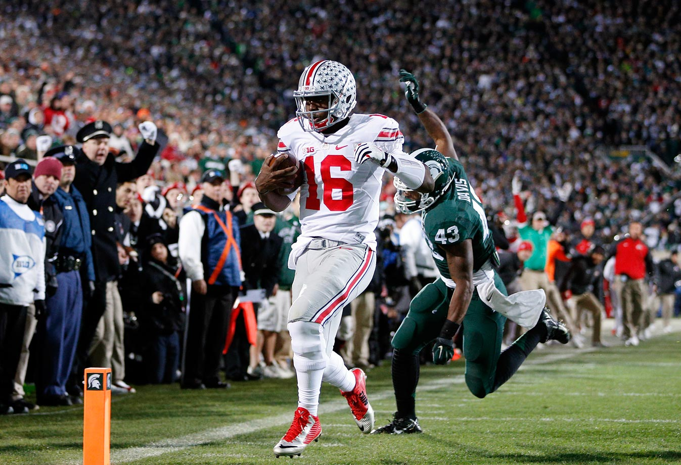 In a College Football Playoff elimination game, Ohio State proved its superiority with a dominant victory in East Lansing. Barrett passed for 300 yards, rushed 86 and scored five touchdowns while Elliott tallied 154 yards on the ground with two scores. The Buckeyes never trailed in the second half.