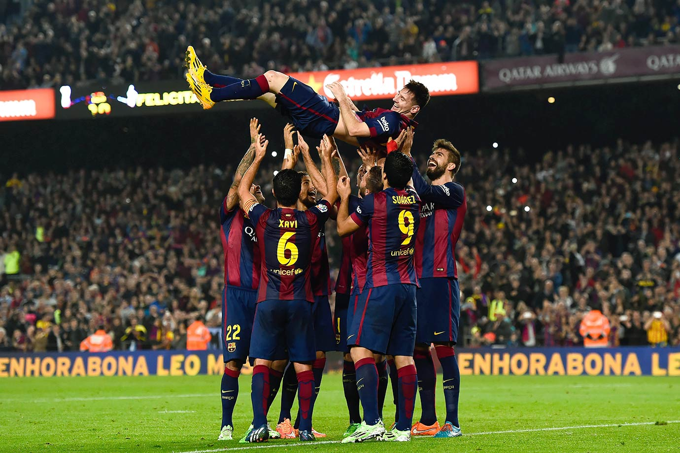 Barcelona's Lionel Messi celebrates with teammates after scoring his team's fourth goal during the La Liga match against Sevilla FC on Nov. 22, 2014 at Camp Nou stadium in Barcelona, Spain.