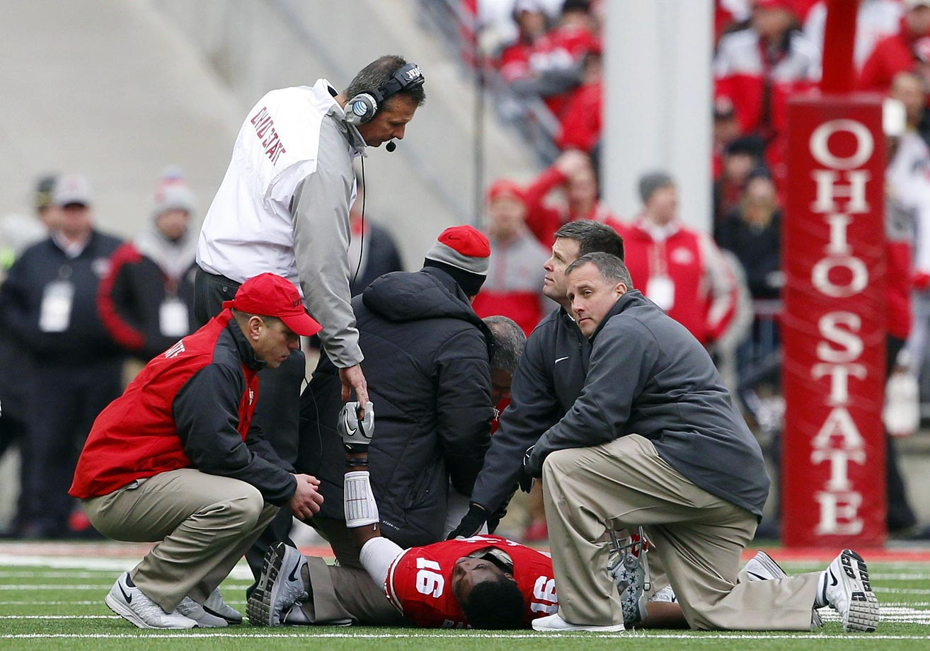 The joy of a closer-than-expected win over their biggest rival was muted by the Buckeyes' sorrow over J.T. Barrett's injury, a fractured ankle that ended his season. After the quarterback went down on the first play of the fourth quarter, Ohio State scored twice to pull away for the victory.
