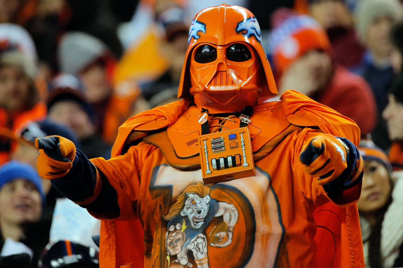 A Denver Broncos fan dressed in an orange Darth Vader costume stands and cheers during the Broncos game against the Oakland Raiders on Dec. 28, 2014 at Sports Authority Field at Mile High in Denver.