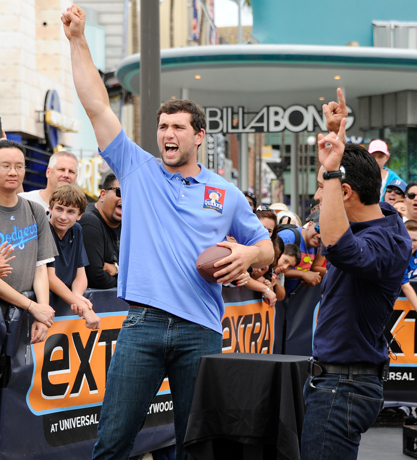 Andrew Luck and Mario Lopez cheer while appearing on ''Extra'' on July 14, 2014 at Universal Studios Hollywood.