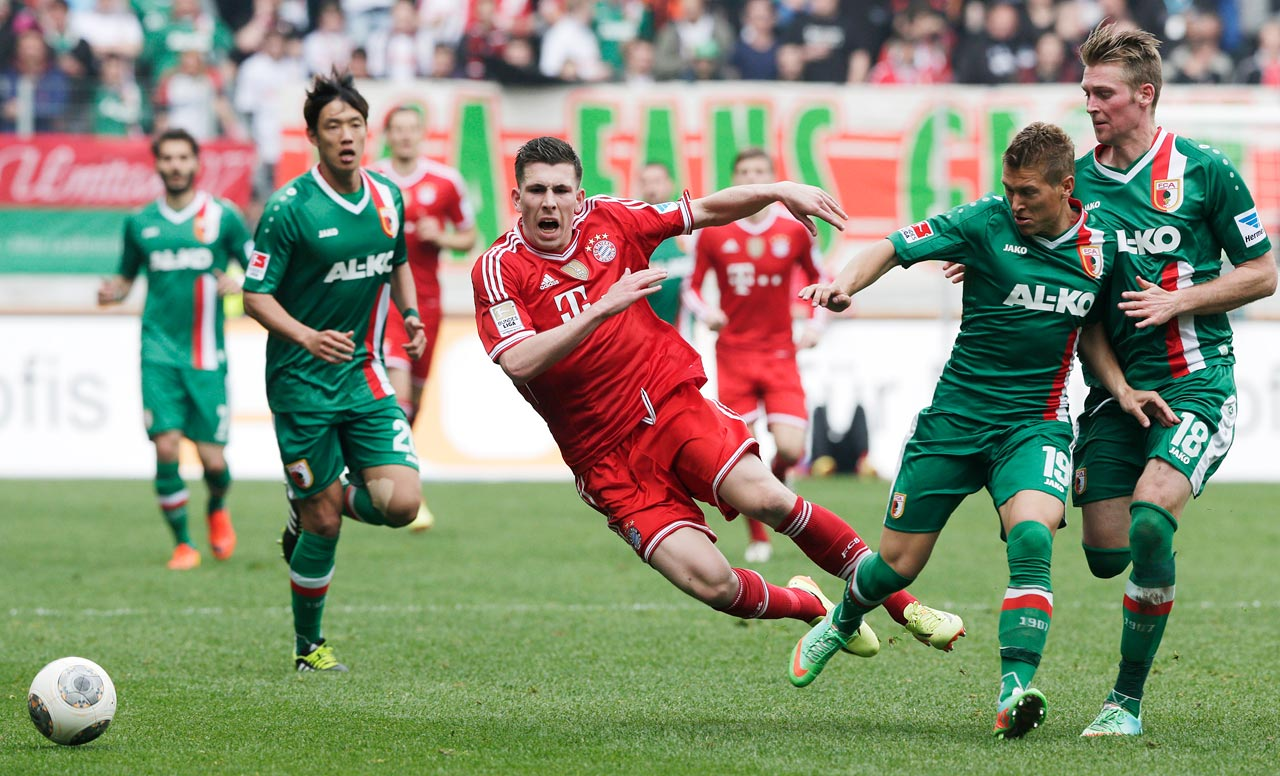Bayern ends a Bundesliga record 54-game stretch without losing by falling 1-0 to FC Augsburg.