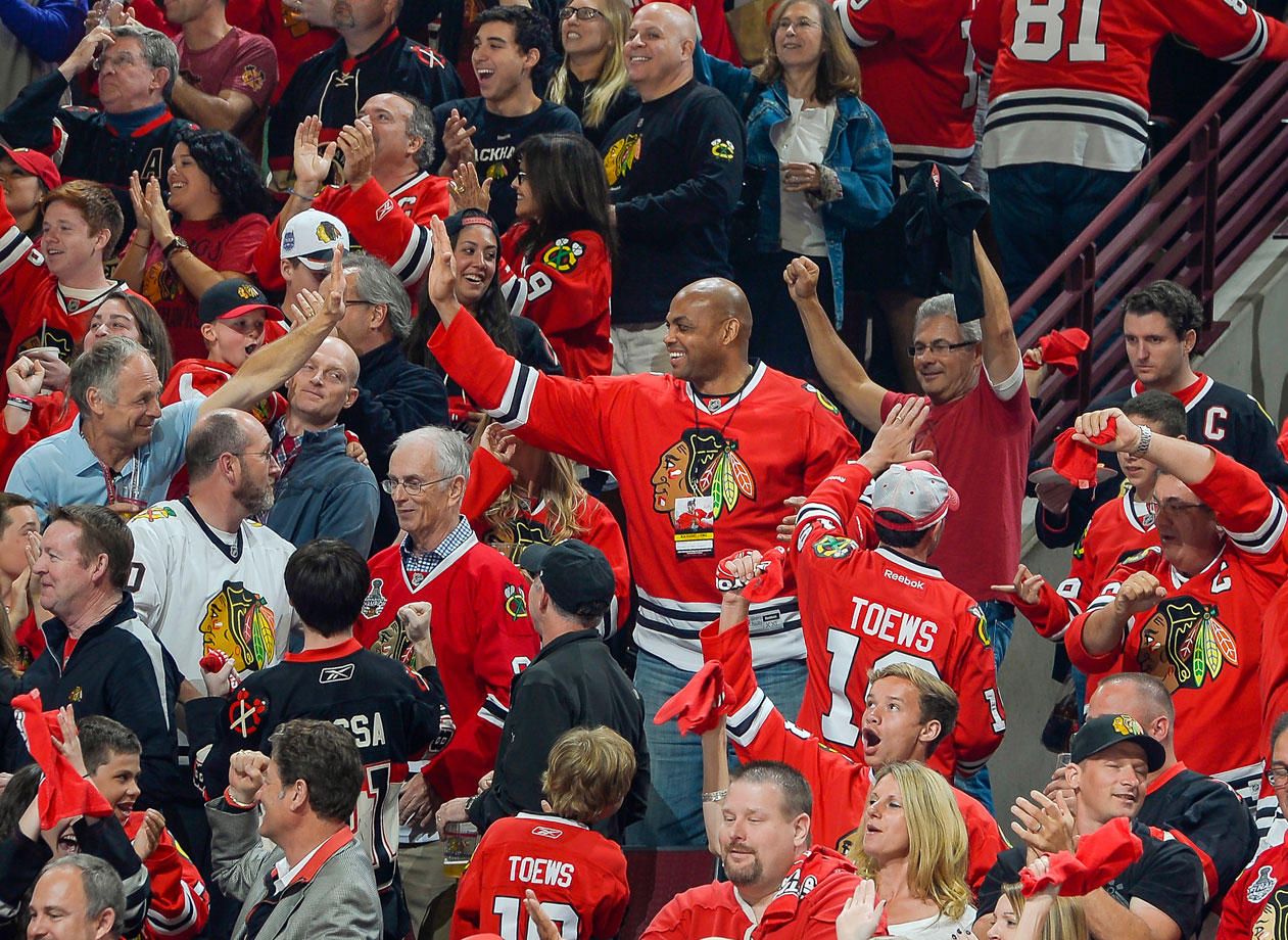 Charles Barkley celebrates with fans after the Chicago Blackhawks scored against the Los Angeles Kings in Game Seven of the Western Conference Final in Chicago.