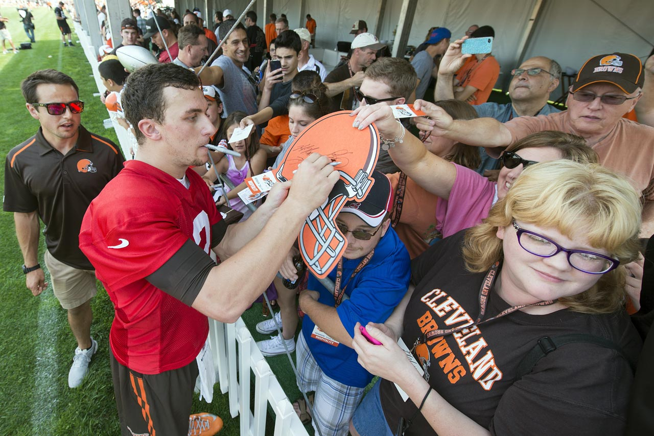 Johnny Manziel signs autographs after practice during training camp at the Cleveland Browns training facility on July 26, 2014.