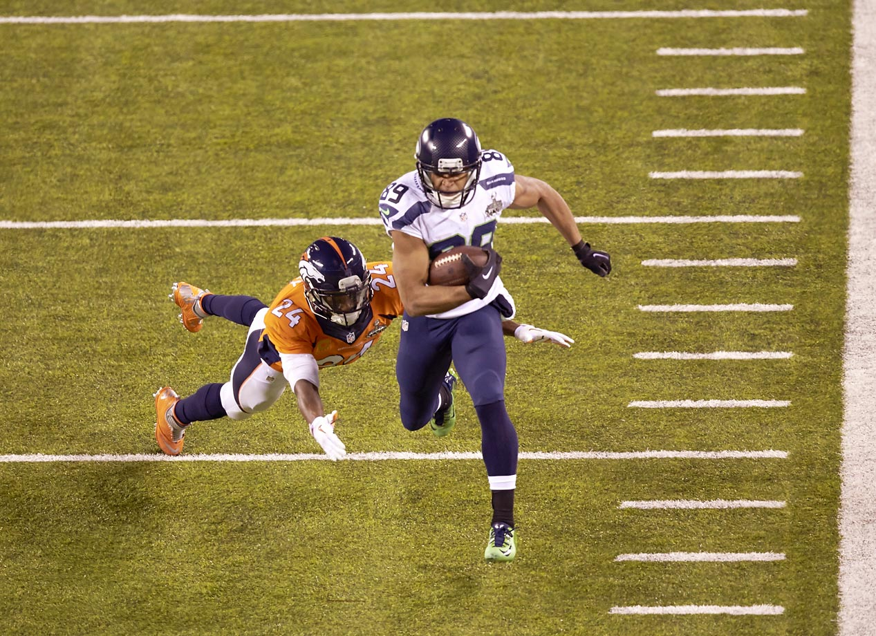 Doug Baldwin tries to escape Champ Bailey in the first Super Bowl played outside in a cold-weather city.
