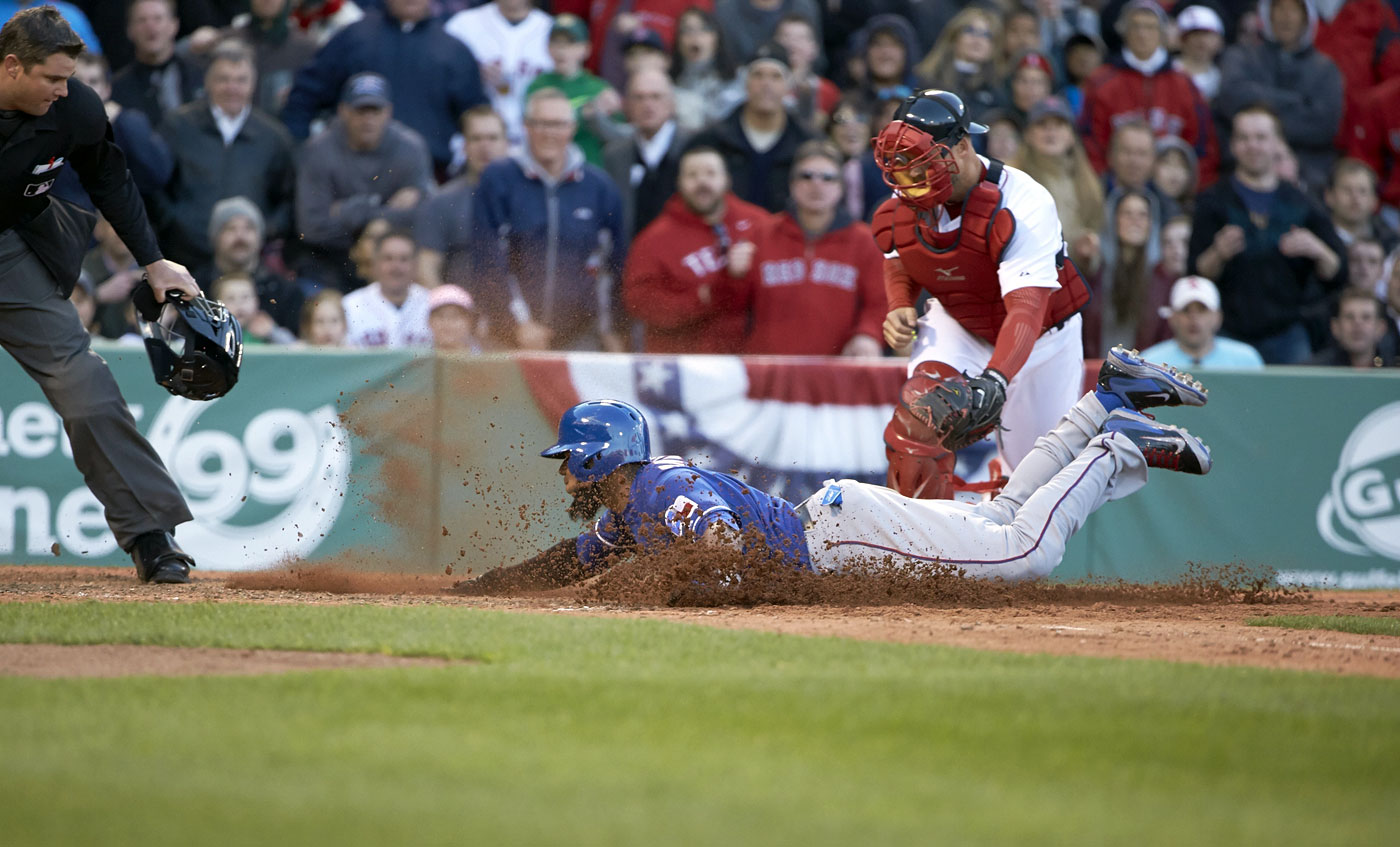 Elvis Andrus slides safely into home past A.J. Pierzynski during the Texas Rangers game against the Boston Red Sox at Fenway Park in                      Boston on April 9, 2014.