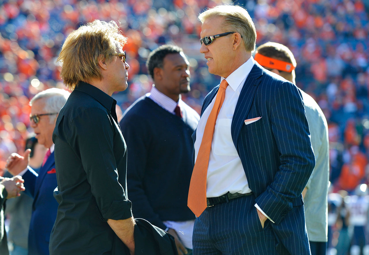Jon Bon Jovi talks with Denver Broncos VP John Elway before the AFC Championship game against New England Patriots in Denver.
